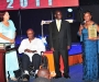 Dr Sarah Matovu, right, accepting her award at the Diaspora Dinner held at the Serena Victoria Ballroom on Thursday. In the wheelchair is her husband, Dr Matovu. PHOTO BY KALUNGI KABUYE