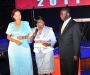:ady Justice Julia Sebutinde after accepting her award at the Diaspora Dinner held at the Serena Victoria Ballroom on Thursday. Left is Dr Maggie Kigozi, patron of the Ugandan Diaspora Association, right is the Vice President Edward Ssekandi PHOTO BY KALUNGI KABUYE