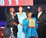 Mr & Mrs Alibaruho recive the awardon behalf of their son Kwatsi Alibaruho, the first African American to command a space mission, at the Diaspora Dinner held at the Serena Victoria Ballroom on Thursday. PHOTO BY KALUNGI KABUYE