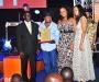 Relatives of Derreck Kayongo collect his award on his behalf at the Diaspora Dinner held at the Serena Victoria Ballroom on Thursday. PHOTO BY KALUNGI KABUYE