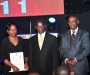Munini Mulera, right, and his wife, lefy, pose for a picture with the Vice President Edward Sekandi at the Diaspora Dinner held at the Serena Victoria Ballroom on Thursday. PHOTO BY KALUNGI KABUYE