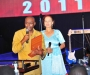 Voice of America broadcaster Shaka Ssali gives his acceptance speech after receiving his award at the Diaspora Dinner held at the Serena Victoria Ballroom on Thursday. Bhind him is Dr maggie Kigozi, the Patron of the Ugandan Diaspora Association PHOTO BY KALUNGI KABUYE